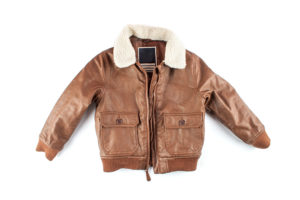 Kid's leather jacket isolated on white background. Clothes isolated